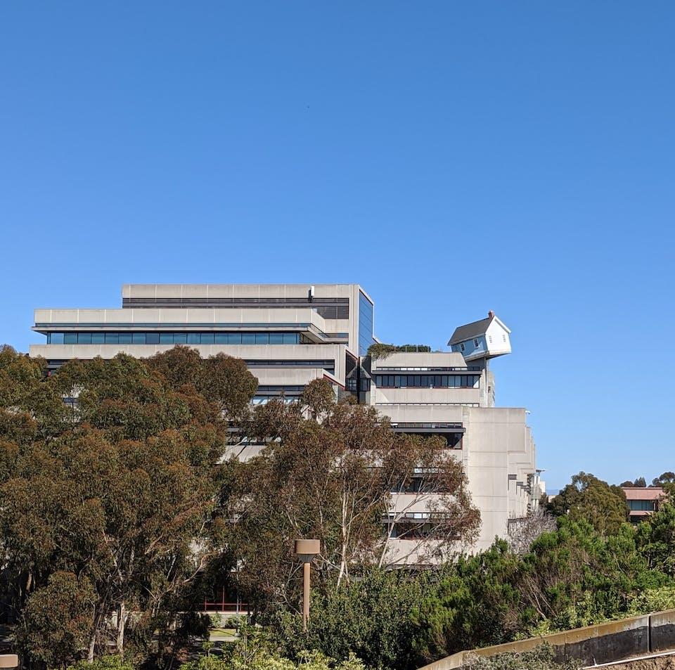 Fallen Star model house teetering on edge of the engineering building at University of California, San Diego