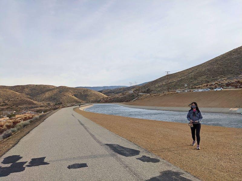 Woman hiking along the Palmdale segment of the California Aqueduct