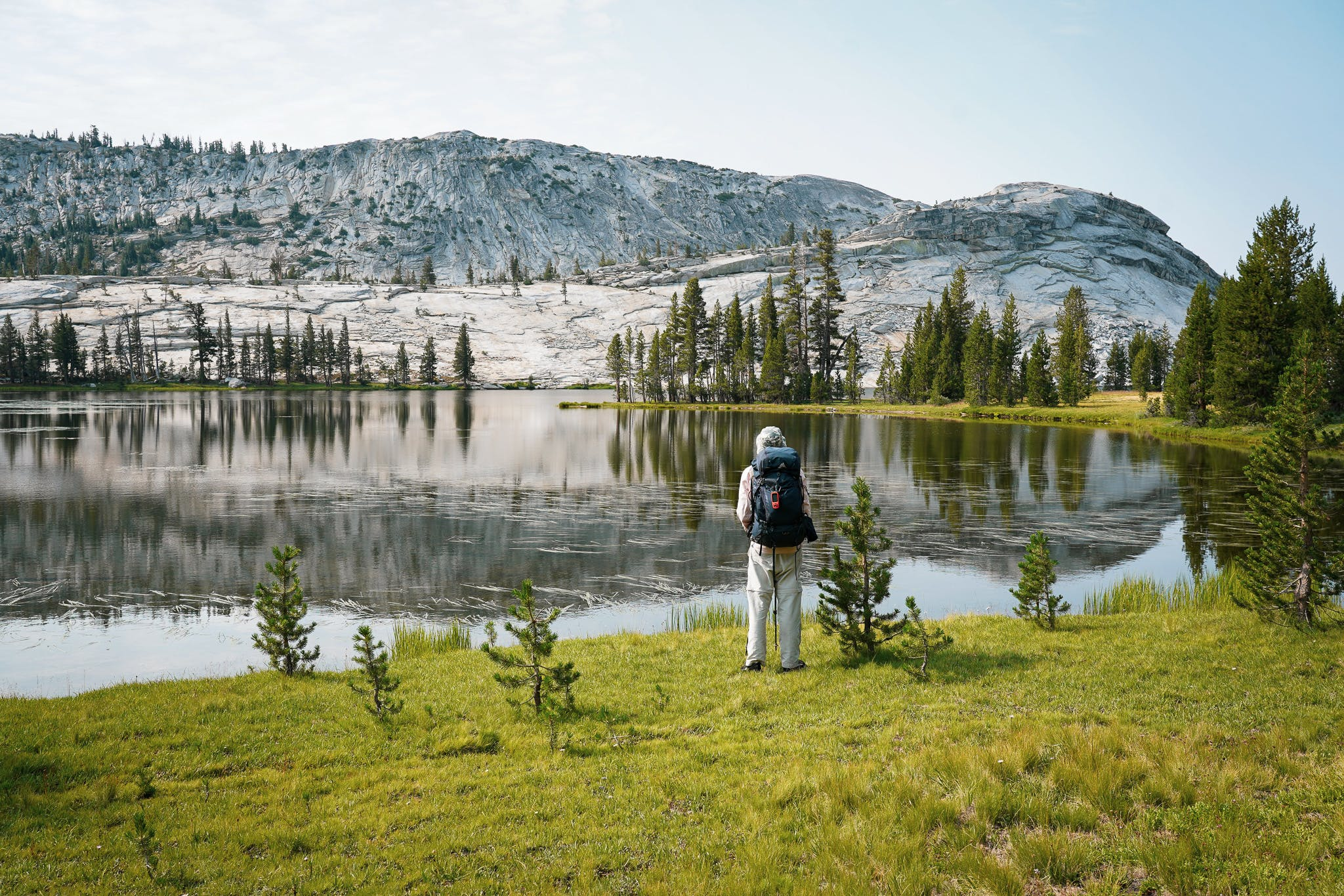 Backpacker at Emeric Lake in Yosemite High Sierra