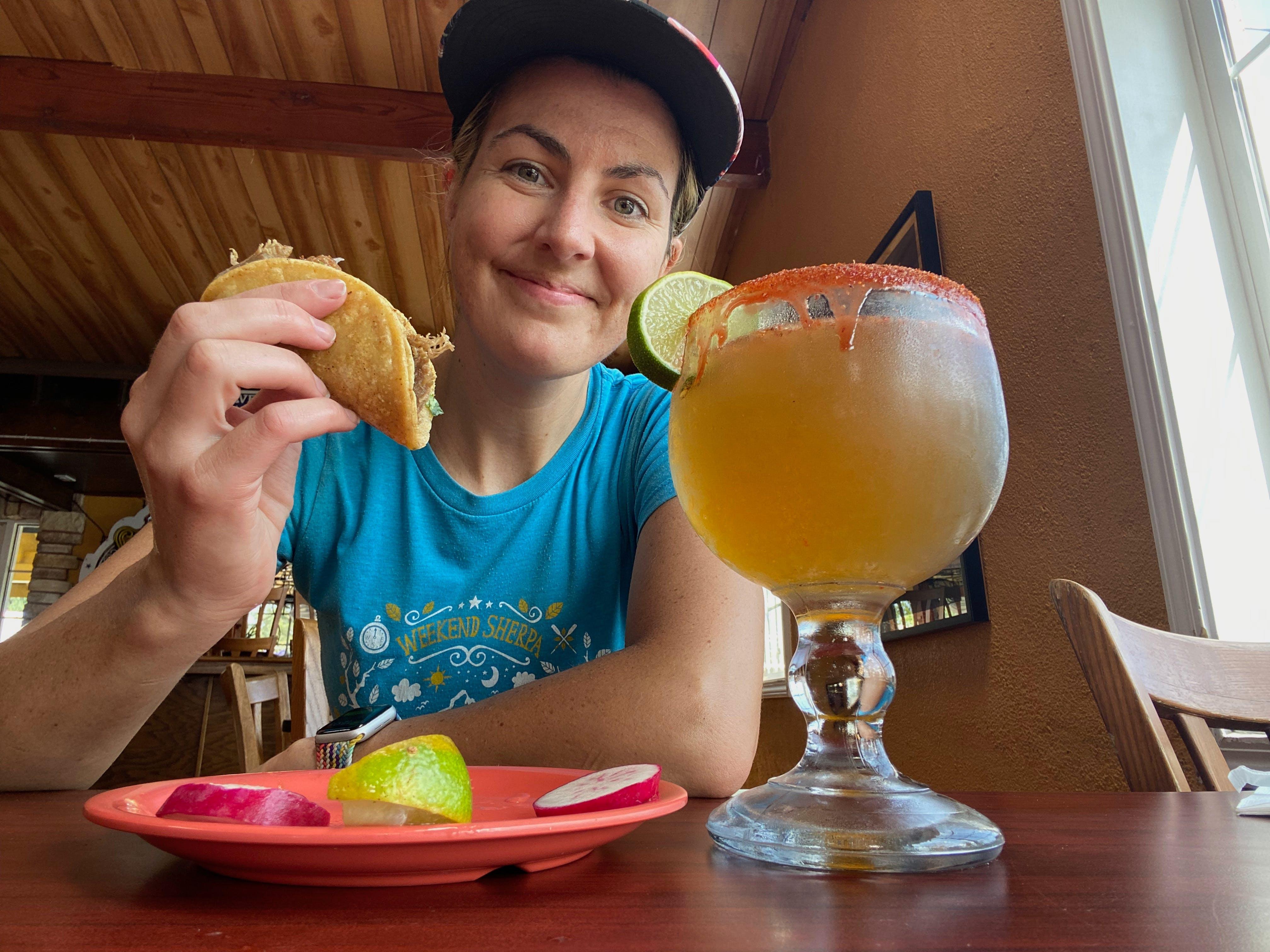 Poe enjoying a taco and a spicey chavela at El Taco De Oro in San Jose