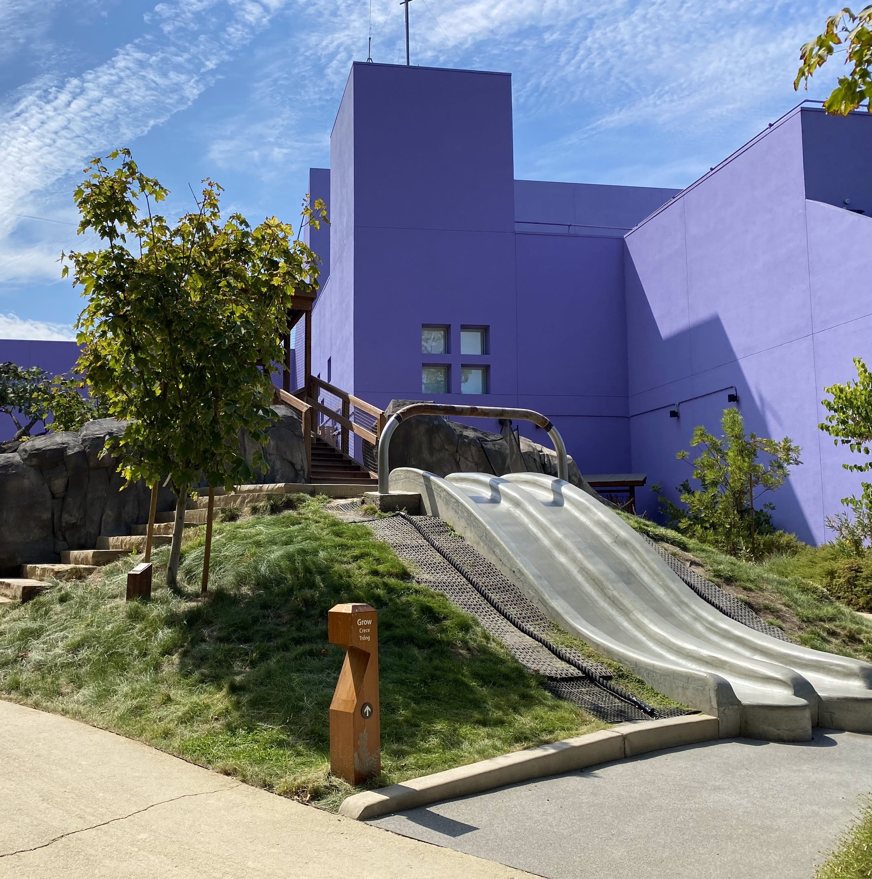Children's Discovery Museum with two paved slides next to each other