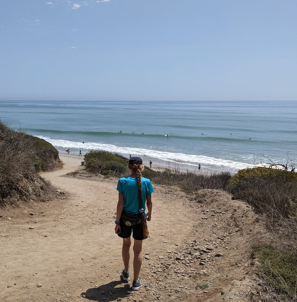 Woman hiking the San Onofre Bluffs Loop Trail overlooking San Onofre State Beach in San Diego County