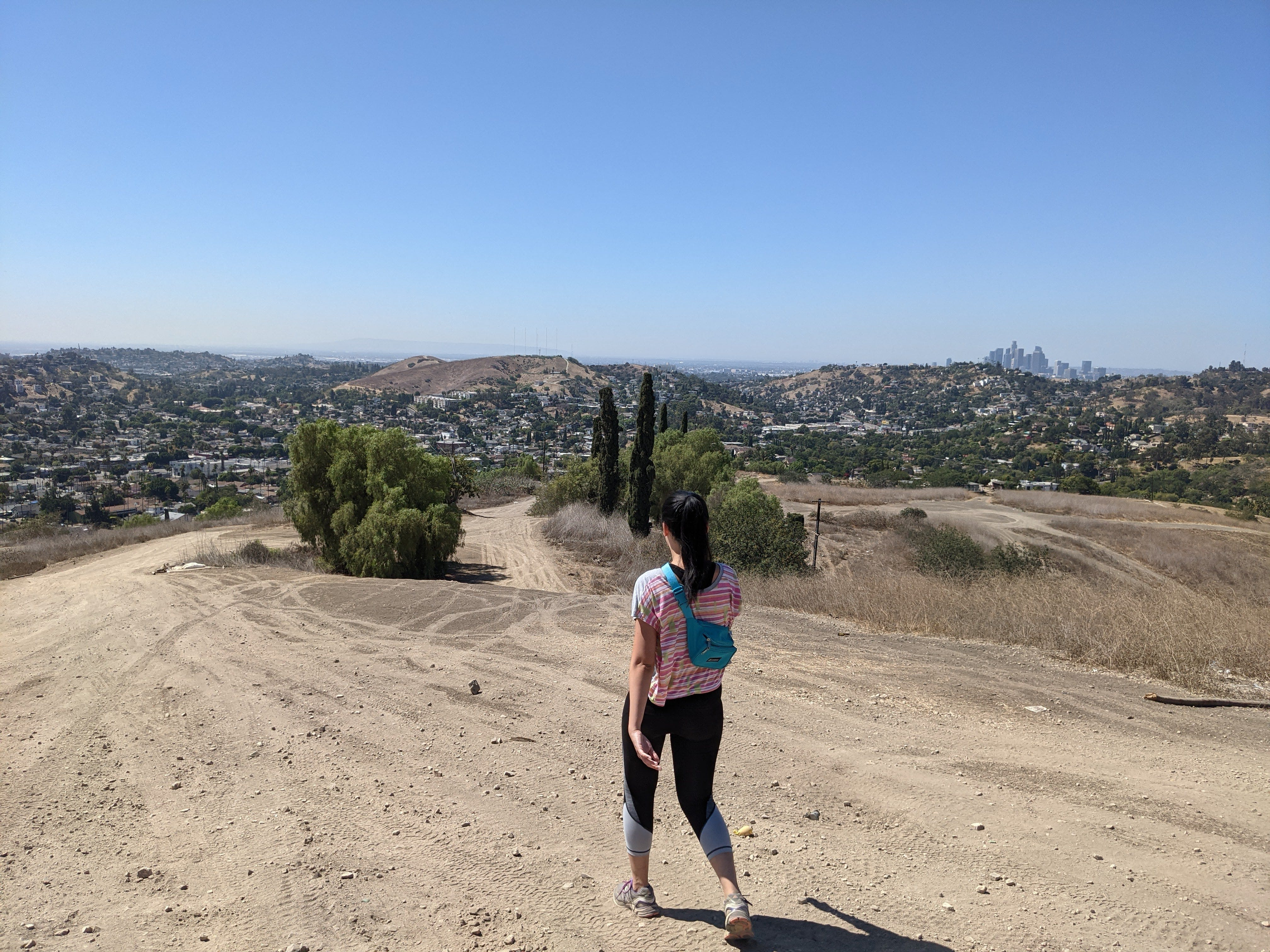 Hiker going down a trail at Elephant Hill Open Space in Los Angeles