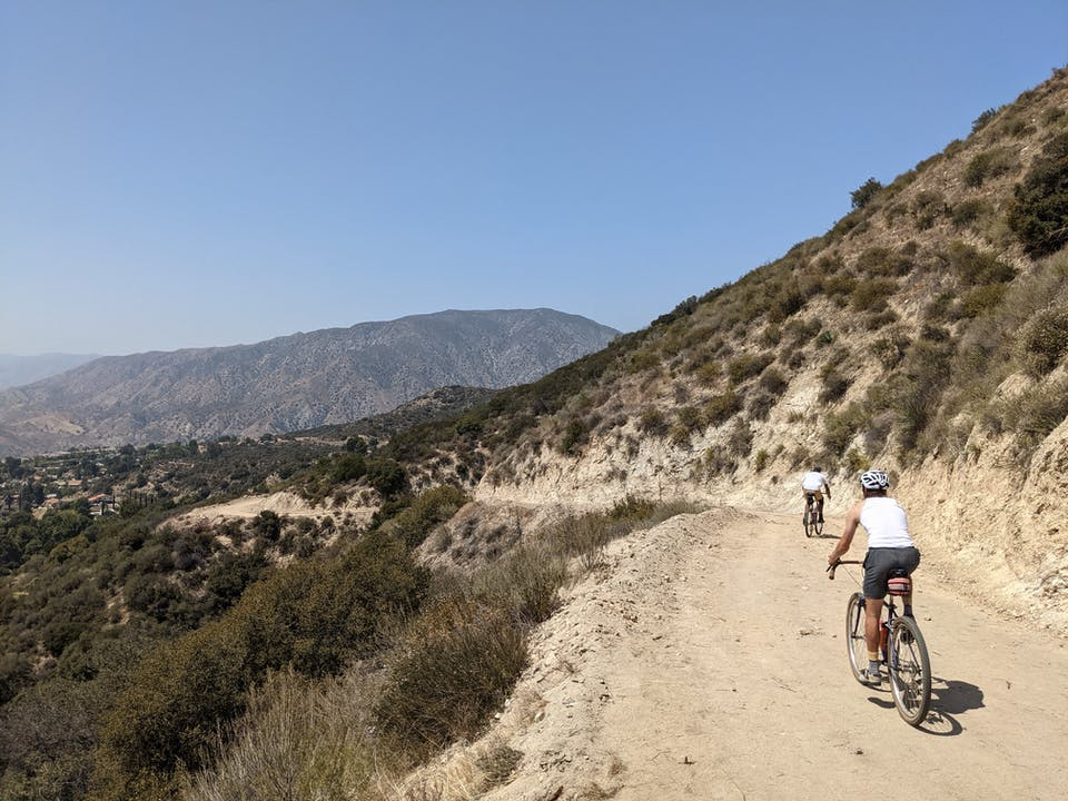 Mountain Bikers on a trail in Haines Canyon Debris Basin in the San Gabriels Southern California