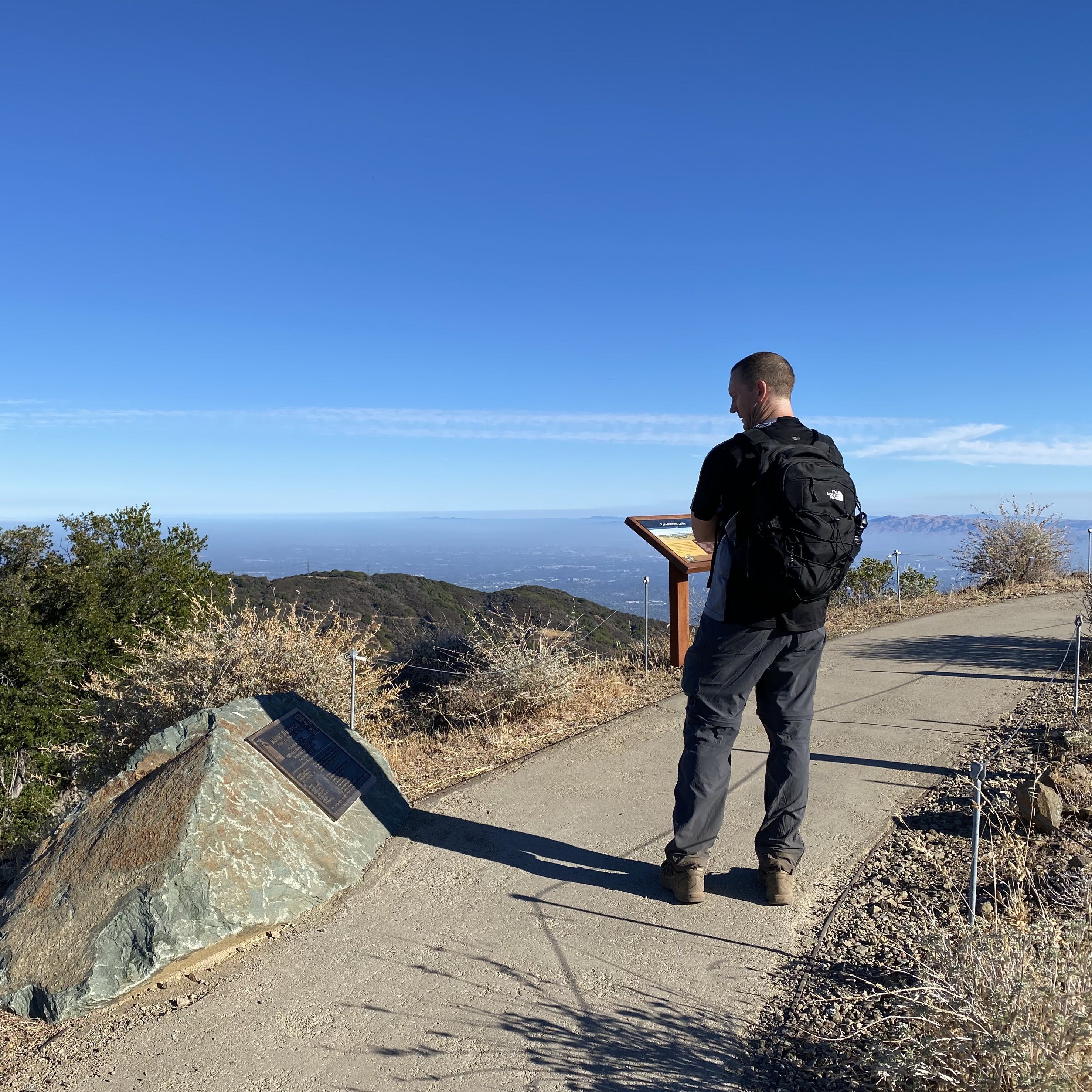 Hiker at the summit of Mount Umunhum in the South Bay