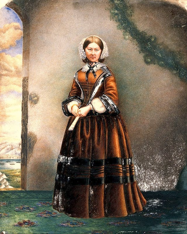 Coloured oil painting of Florence Nightingale.  A Crimean or Turkish scene is visible on the left.