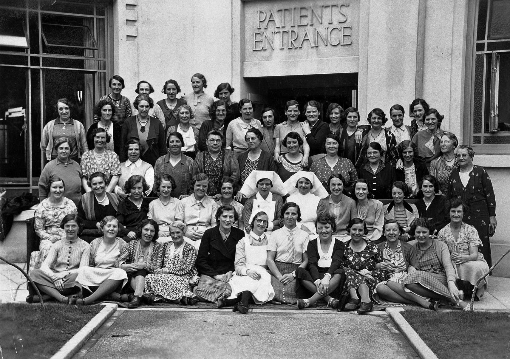 A group of women pose outside of the patients entrance at the Birmingham Hospital Saturday Fund Convalescent Home.