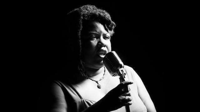 Black and white photographic portrait of Cheryl Martin performing holding a microphone.