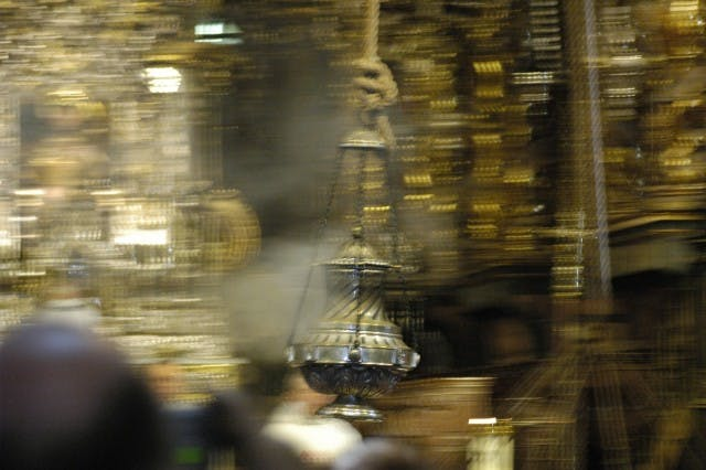 The incense burner in Santiago de Compostela, Spain is pictured in motion.