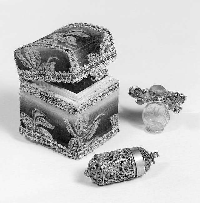 Walpurgis oil with a small damask box with filigree casket and small glass flask for oil.