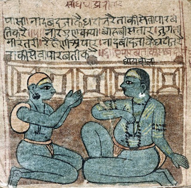 Two seated Nath yogis in conversation