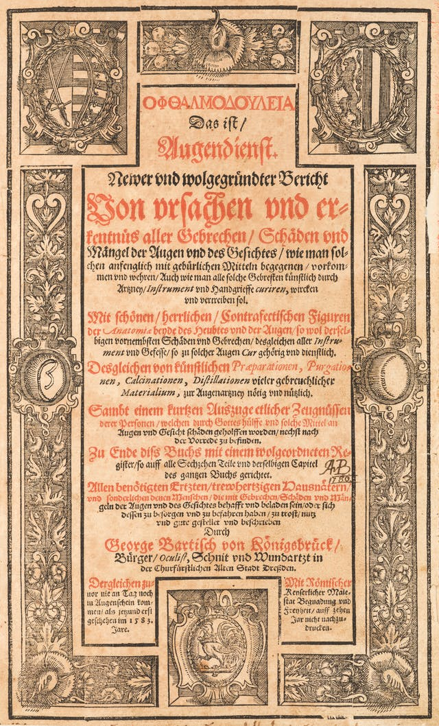 Photograph of the title page of a 16th century book with ornate engravings and red and black text. The text is written in German.