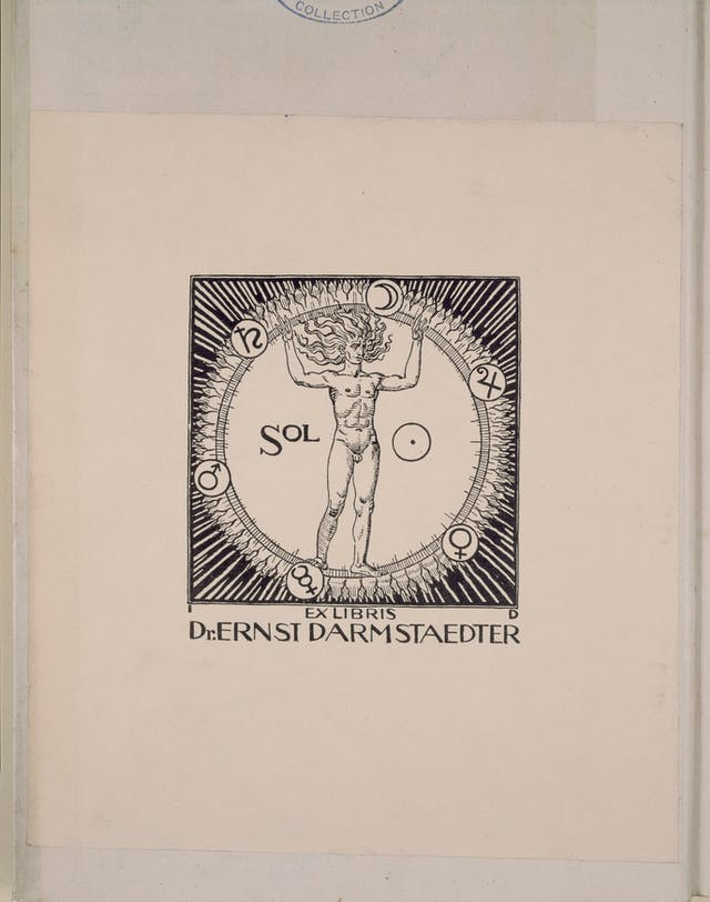 Bookplate depicting a nude male figure standing inside a ring with flames and cosmological symbols around the edge.  Below the image are the words