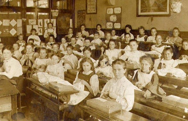 Victorian schoolgirls in a needlework class
