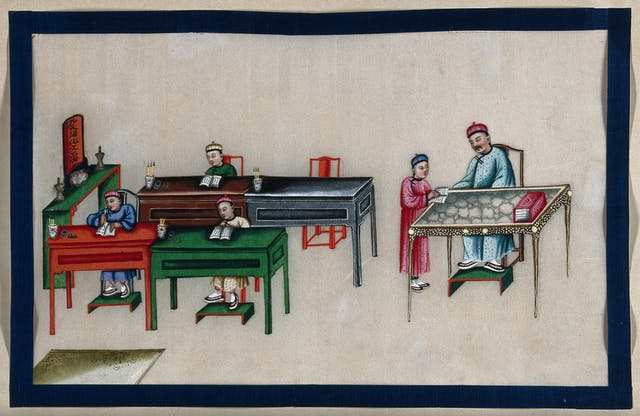 Painting of a classroom showing three students at their desks with books in front of them, and one student holding their book speaking to the teacher at their desk.