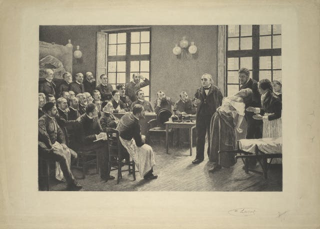 Jean-Martin Charcot demonstrating hysteria in a patient at the Salpetriere. Lithograph after P.A.A. Brouillet, 1887