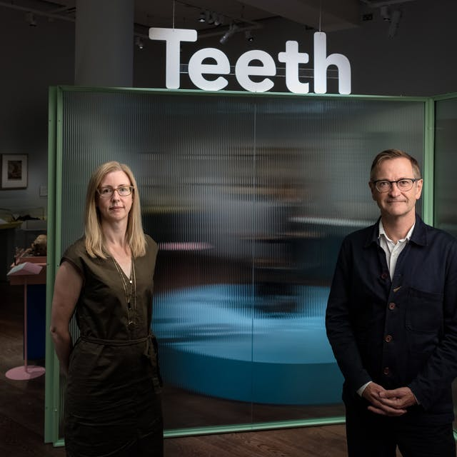 Emily Scott-Dearing and James Peto stand at the entrance to the Teeth exhibition