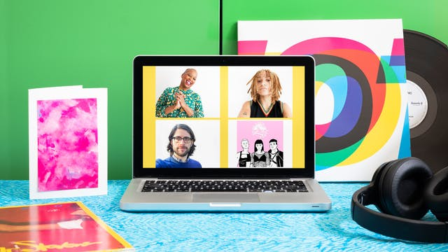 Photograph of a laptop on a desk with a blue patterned surface.  On the laptop screen is a portrait of Gaylene Goud, Rene Matić, Ben Walters and Queer House Party. Next to the laptop are headphones and a pink card. In the background is a LP vinyl record leaning against a bright green cabinet.