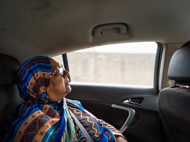 Photograph of Sarifa Patel relaxing in the back of a taxi.