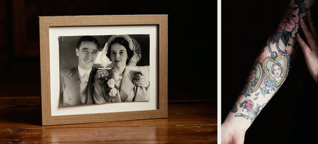 Photographic diptych made up of one landscape orientation and one portrait orientation image. The image on the left shows a wooden tabletop on which a small framed photograph is propped up. The black and white print is in a wooden frame and shows a man and a woman on their wedding day, smiling to camera, The man on the left has his arm around the woman. The image on the right shows a close-up of a woman