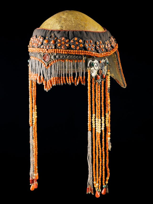 Image of beaded ceremonial headdress overlaying a human skull