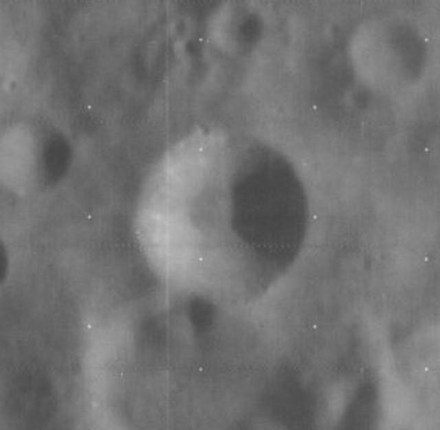 A black and white image of a crater on the moon.