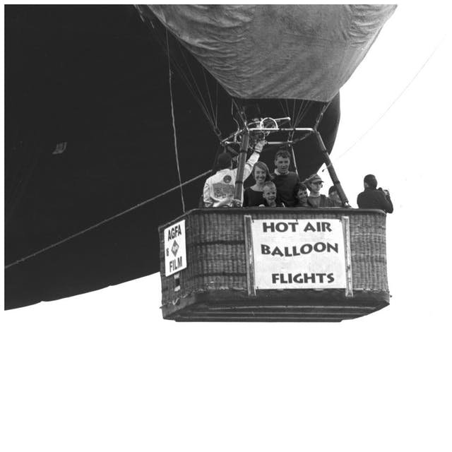 Doctored image of hot air balloon with people in the basket