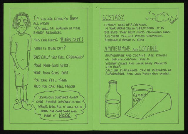 Handmade leaflet with black handwriting and drawing on green paper.