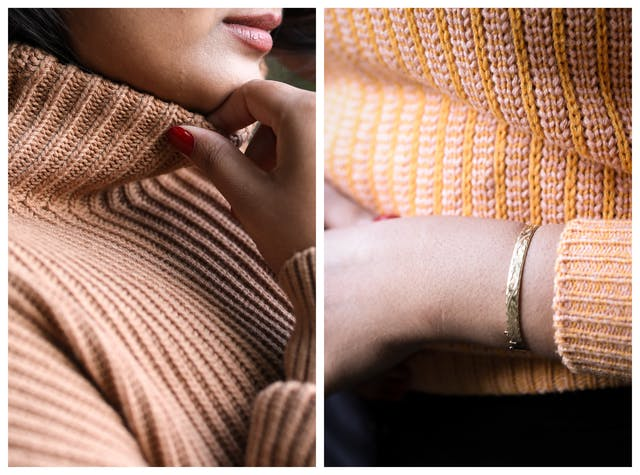 Photographic diptych. The image on the left shows a close-up of a woman wearing a woollen knitted high necked cream coloured jumper. At the top of the frame her lips can just be seen in profile. Her right hand is gently holding the top of the neck of the jumper between her thumb and forefinger. The texture of the jumper can clearly been seen. The image on the right is also a close-up of a woman wearing an orange patterned woollen knitted jumper, but shows her torso. Her left arm is held across her body and a short section of her skin can be seen around her wrist and lower arm. She is wearing a gold bracelet.