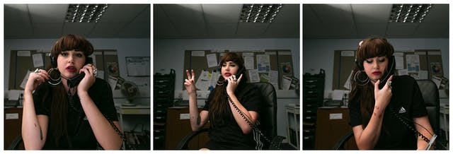 Photographic triptych showing the same woman in each image, sat in an office environment. In the left hand image the woman holds a landline telephone receiver to her left ear, her right hand is raised holding her large hoop earrings. She is looking straight into camera. In the middle image she holds the receiver to her left ear and she is looking away to camera left, mid sentence. Her right hand is raised.In the right hand image she holds the receiver to her left ear with her right hand and she is looking down to the desk.