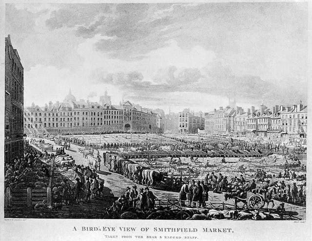 Black and white illustration offering a wide perspective of a cattle market - full of cows and people - surrounded by tall buildings.