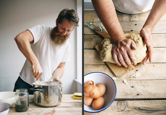 Photographic diptych. The image on the left shows a bearded man in a white t-shirt standing at a wooden kitchen table, stirring a mixture in a large saucepan with a wooden spoon. The saucepan is surrounded by kitchen utensils, a jar of green liquid and a couple of bowls. The image on the right shows a wooden kitchen table from above. A man