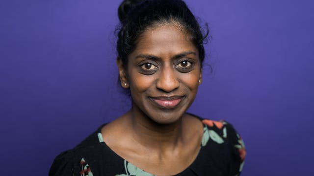 Head and shoulders photographic portrait of Nadia Nadarajah on a purple background.