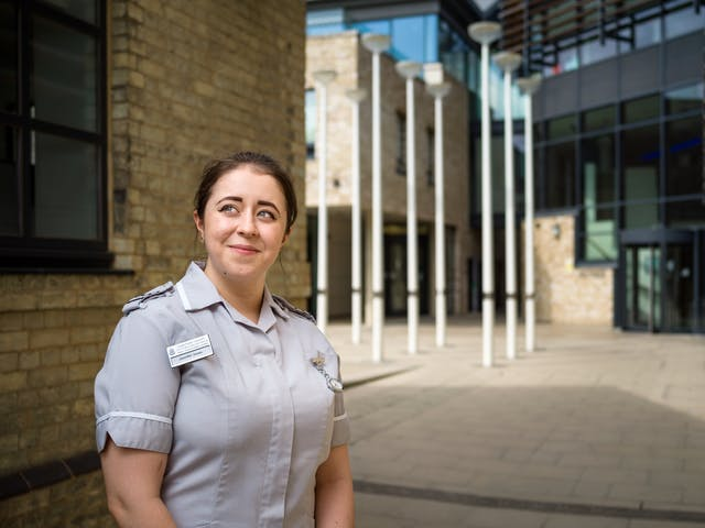 Photographic portrait of Jenny Jones, trainee nurse outside Anglia Ruskin University, Cambridge.