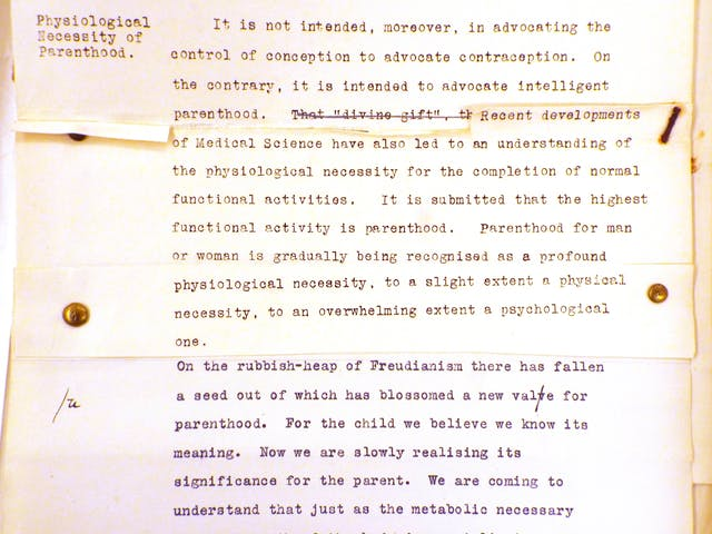 Photograph of some fragments of typed text, stapled and pinned together into a single sheet.