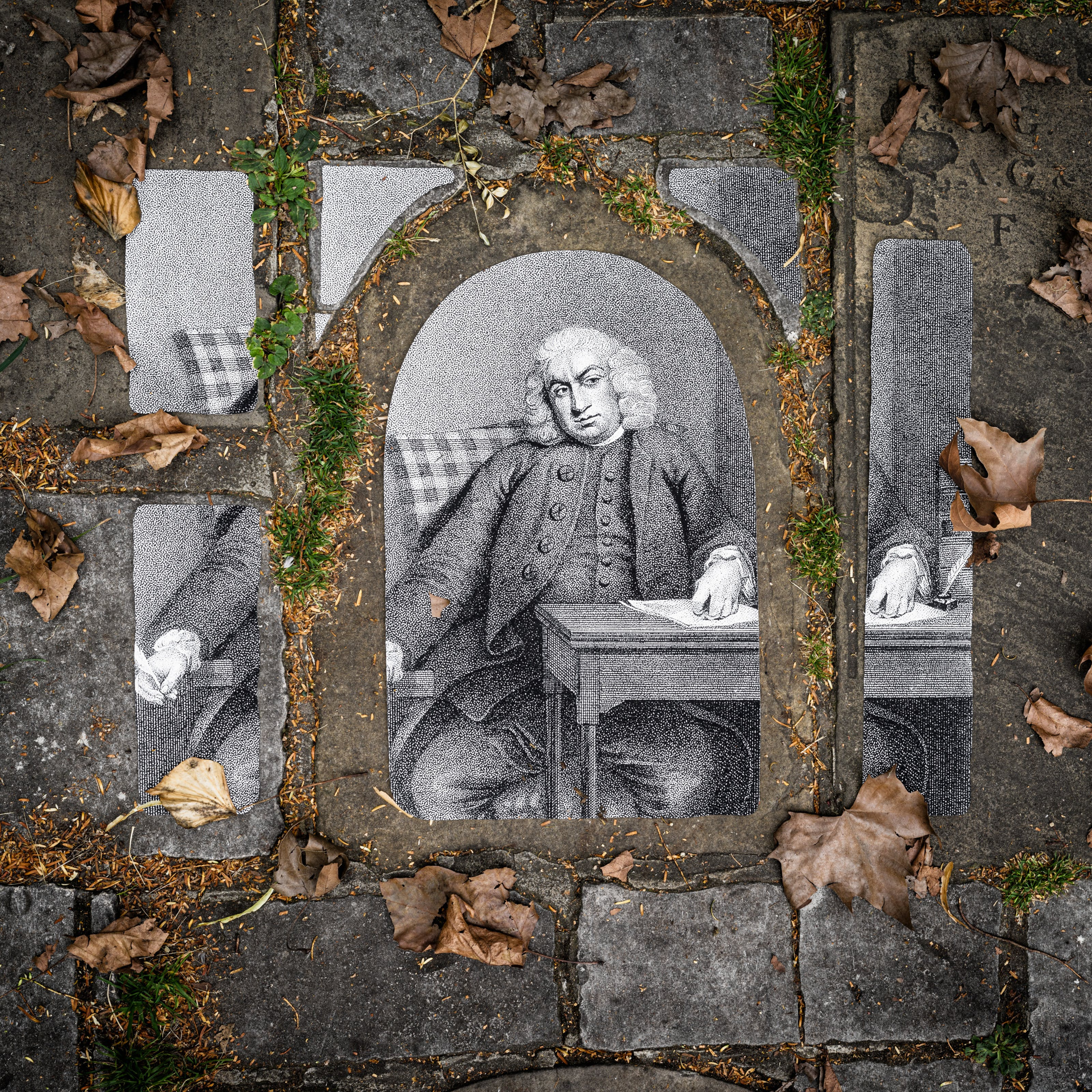 Photograph of an historical portrait drawing of Samuel Johnson placed on a path made out of paving slabs of different shapes and sizes. The portrait is cut into different shapes and sizes to match the paving stones beneath. Grass is growing between the slabs and leaves cover the ground.