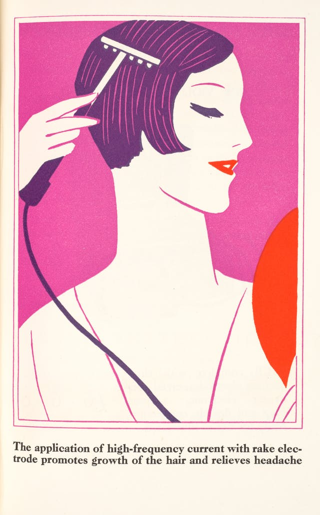 Photograph of a page from an illustrated booklet. The illustration in red, purple and violet shows the head and shoulders of a woman holding a wired handheld device against her scalp. The image is captioned,