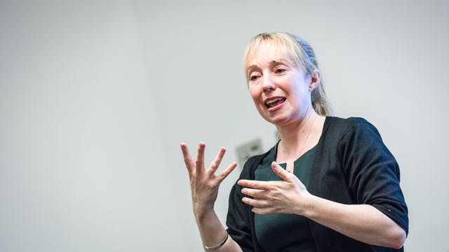 Photograph of a British sign language interpreter translating at the Wellcome Collection.