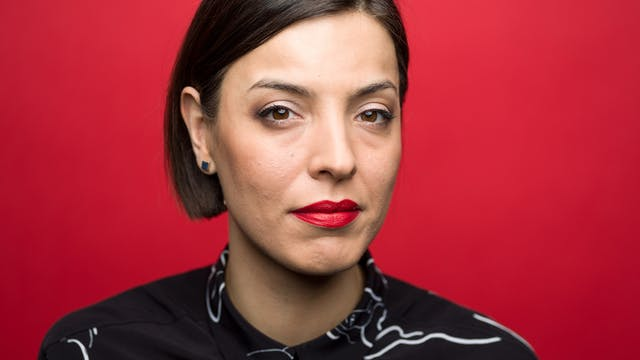 Photographic head and shoulders portrait of Ilona Sagar against a red background.