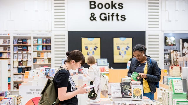 Photograph of people browsing in the Wellcome Collection bookshop.