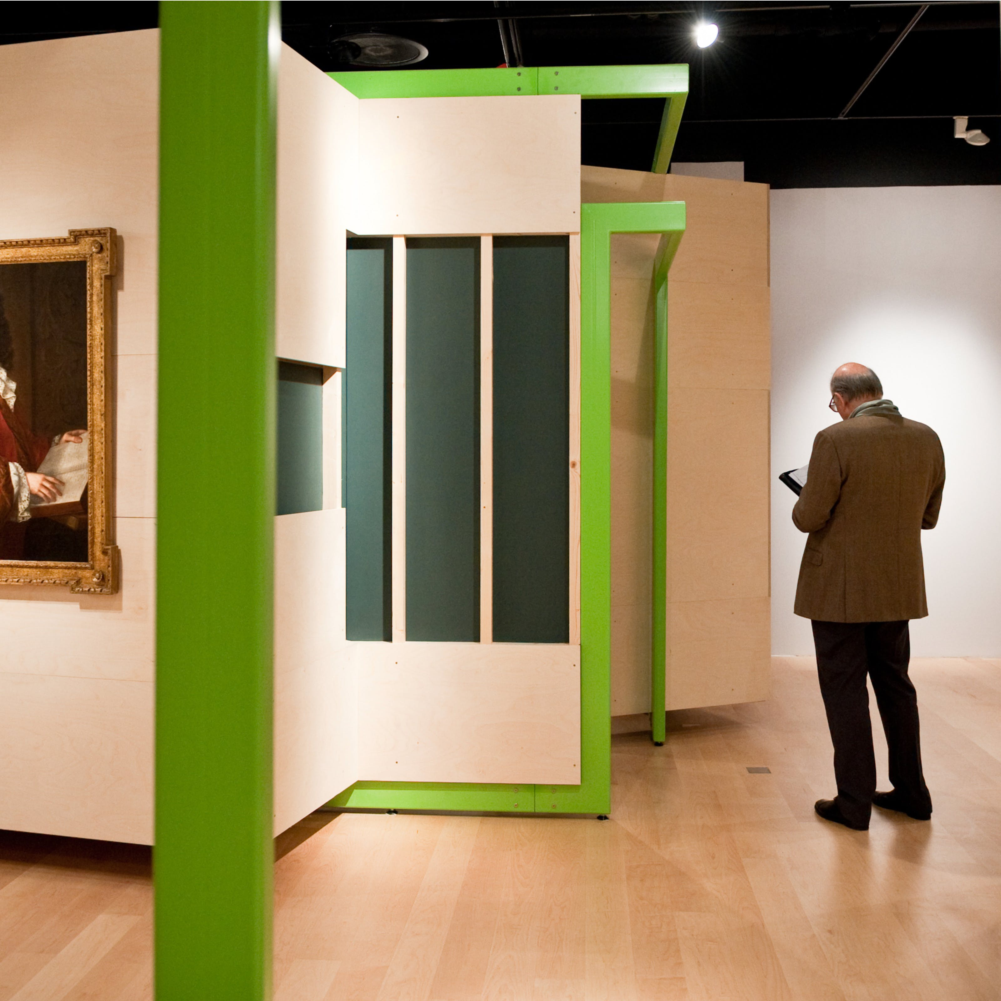 Photograph of a visitor exploring the Identity exhibition at Wellcome Collection.