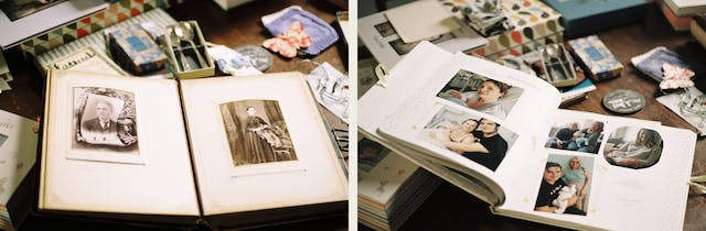 Photographic diptych. Both images show an open family photograph album resting on a tabletop covered in other memorabilia such as loose photographs, small boxes and keepsakes. The image on the left shows an old family album with two sepia prints mounted one on each page. The print on the left page shows a Victorian era man wearing a collar and tie. The print on the right page shows a Victorian era woman standing in a formal studio setting in a long dress. The image on the right shows a modern family album open on a page with several photographs showing the birth of a new baby in hospital and the first time it met its mother, father and wider family.