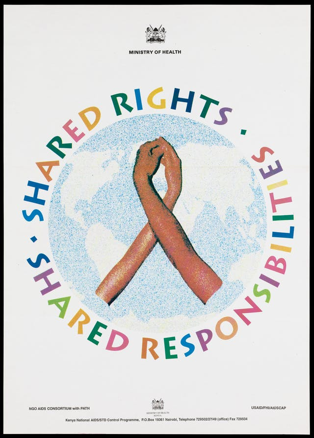 Two hands wrap around each other to form the shape of the AIDS red ribbon against a grainy backdrop of the world within a circle inscribed with the slogan