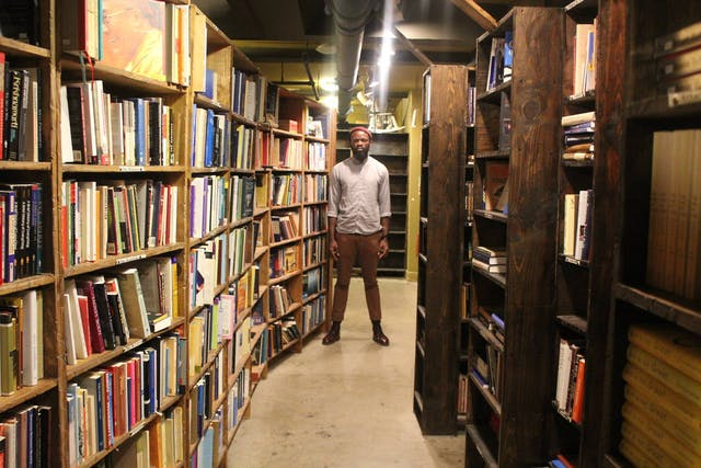JJ Bola in a library.