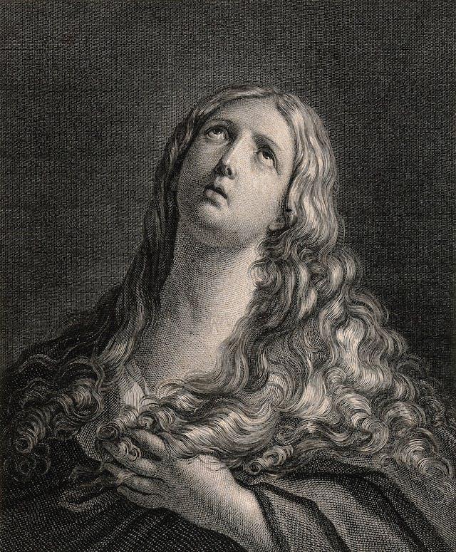 Black and white headshot drawing of Saint Mary Magdalen, looking upwards.