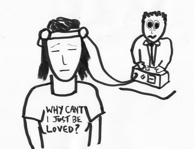 Black and white cartoon drawing showing a woman wearing a brain activity head harness connected to a machine in the background operated by a man. The woman has her eyes shut and is wearing a t-shirt with the words,
