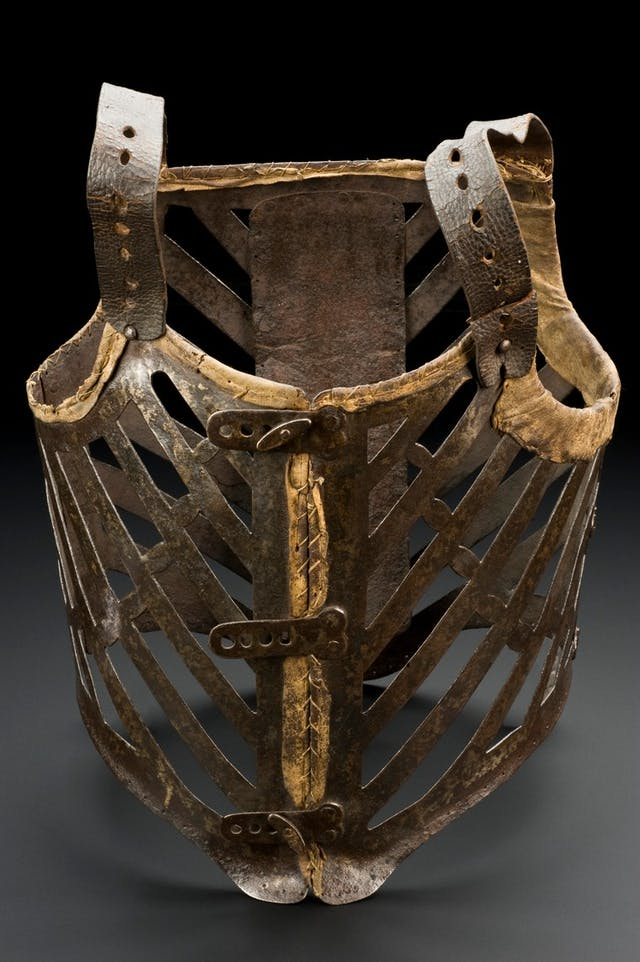 Photogaph of a metal and leather corset to fit an adult male, 1601-1800