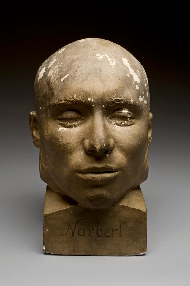Image of death mask, a painted plaster head representing French criminal Norbert