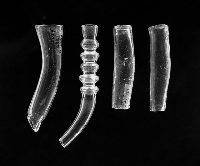 Image of four clear glass tubes.