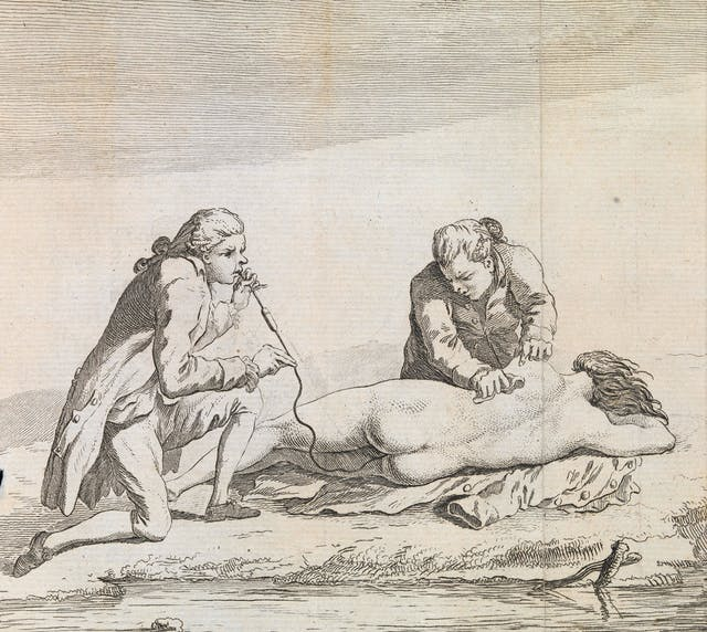 Engraving showing a naked woman laying beside a river whilst one man holds her shoulder and another blows into a pipe with a tube that goes into the woman
